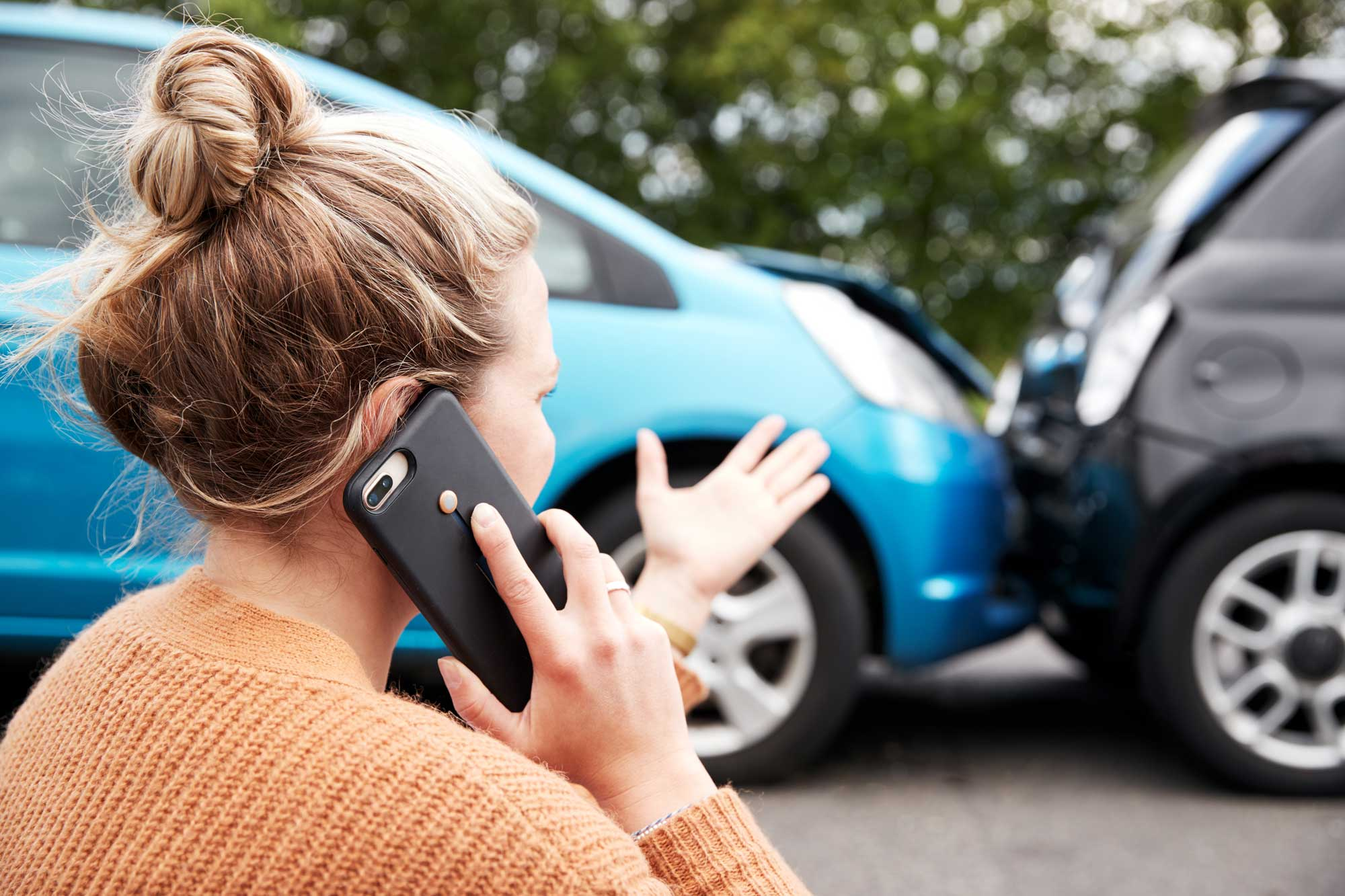 Car accident victim calling automobile accident layer